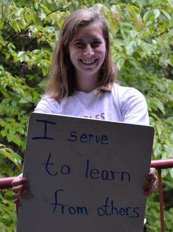 Amanda-Gaffrey-Holding-Why-I-Serve-Sign