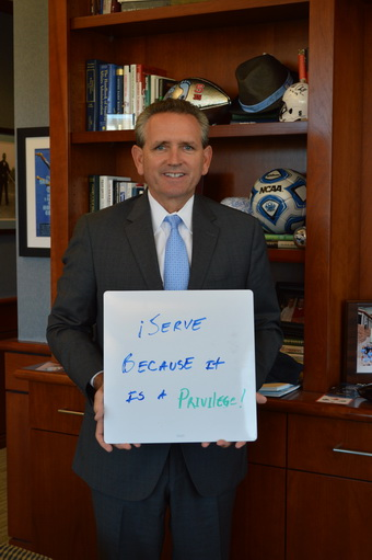 Bubba-Cunningham-Holding-Why-I-Serve-Sign