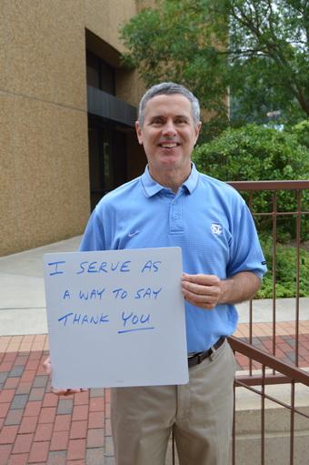 Derek Galvin Holding Why I Serve Sign