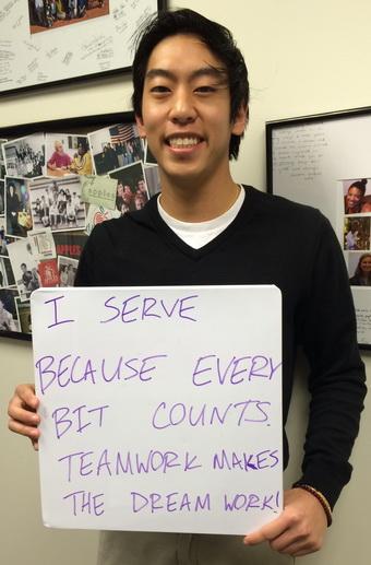 Eric Luu Holding Why I Serve Sign