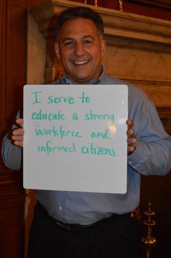 Greg Gangi Holding Why I Serve Sign