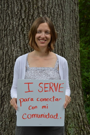 Hannah Gill Holding Why I Serve Sign