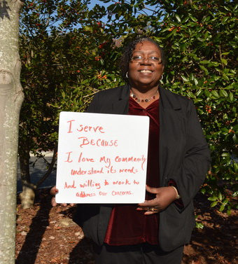 Joann Shire Holding Why I Serve Sign