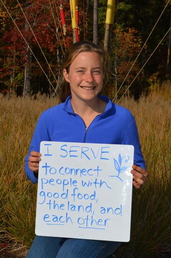 Julia Sendor Holding Why I Serve Sign