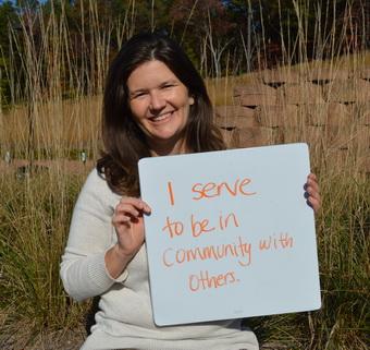 Leslie Parkins Holding Why I Serve Sign