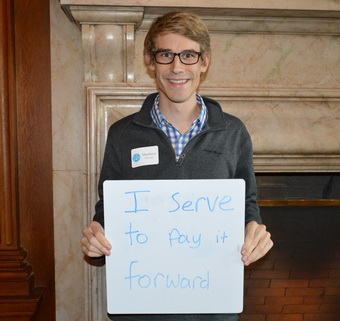 Matthew Givens Holding Why I Serve Sign