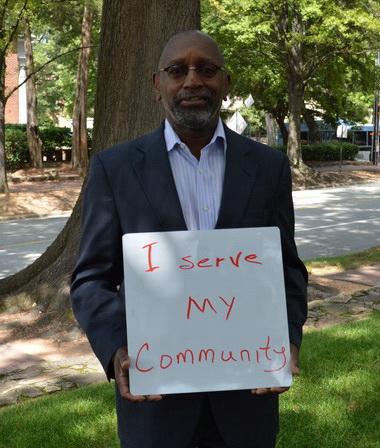 Melvin Jackson Holding Why I Serve Sign