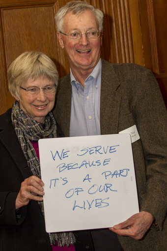 Ned and Ginny Brooks Holding Why I Serve Sign
