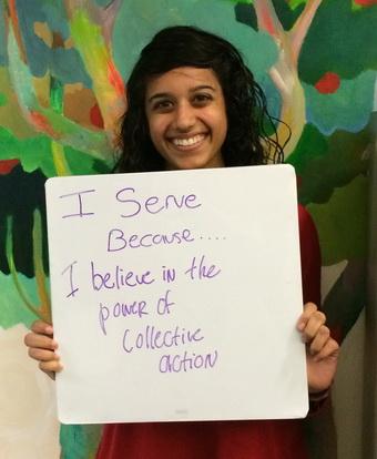 Priya Sreenivasan Holding Why I Serve Sign