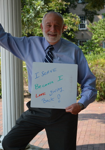 Ron Strauss Holding Why I Serve Sign