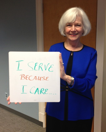 Shirley Ort Holding Why I Serve Sign