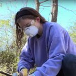 student where's protective mask while using saw for disaster relief