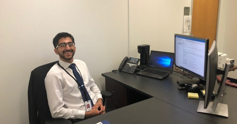 Carolina senior Purshotam Aruwani at his desk in the N.C. Department of Public Safety, during his 2019 APPLES Service-Learning summer internship.