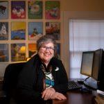 lynn blanchard sitting at her desk