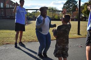 kids play jump rope in schoolyard