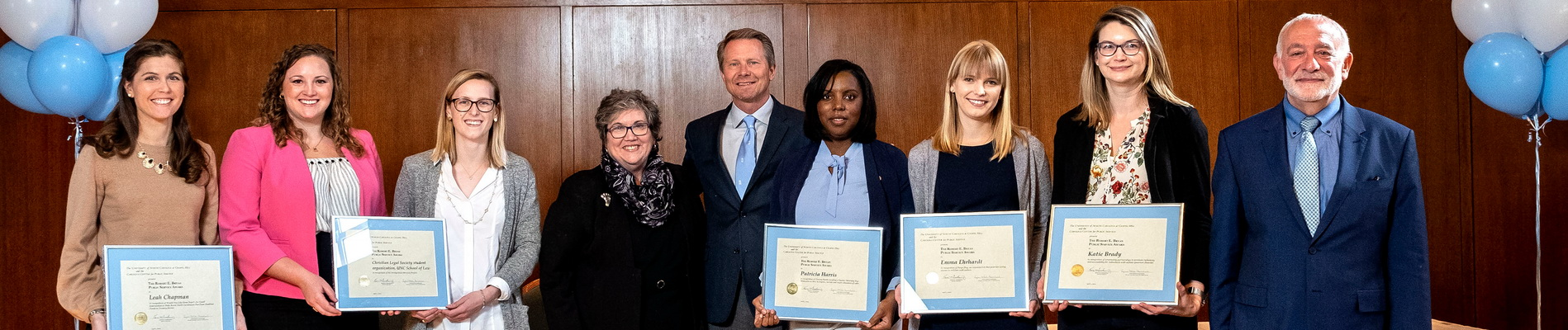 Bryan award recipients stand with awards