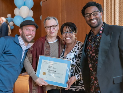 Professor Della Pollock poses with three colleagues after winning Ned Brooks Award
