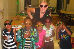 Kesson Anderson and five children pose with sunglasses in a classroom