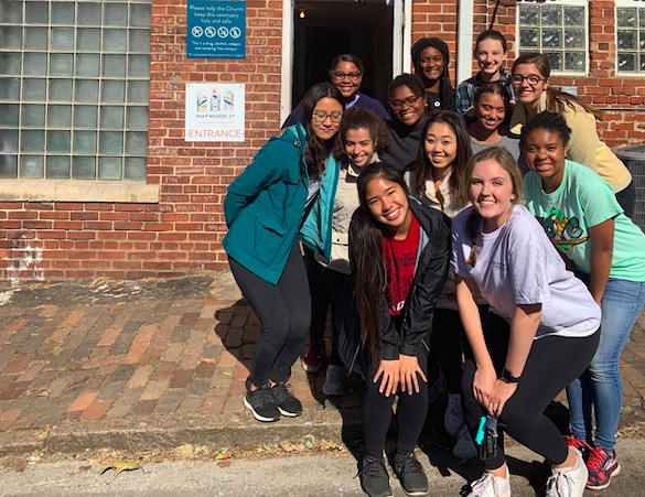 The 2019 Hunger and Homelessness Alternative Fall Break cohort in front of Haywood Street Church