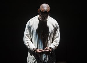Kelly depicted with hands chained during a performance