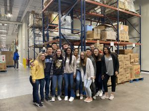A group of students in a warehouse