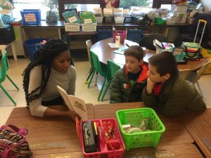APPLES Student reads elementary students a story